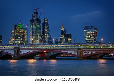 Blackfriars Bridge and the City of London at night in August 2018