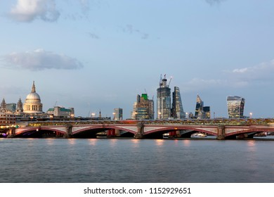 Blackfriars Bridge and City of London viewed from the South Bank of the River Thames at Twilight