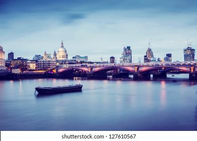 Blackfriars Bridge in London at twilight.