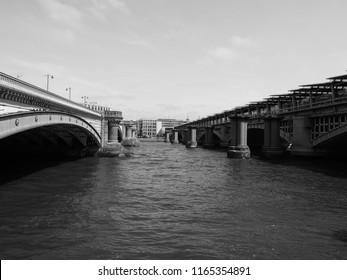 Blackfriars Bridge over River Thames in London, UK in black and white