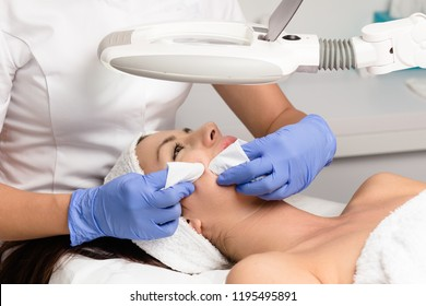 Blackhead cleansing on woman face during facial treatment at luxury beauty clinic.