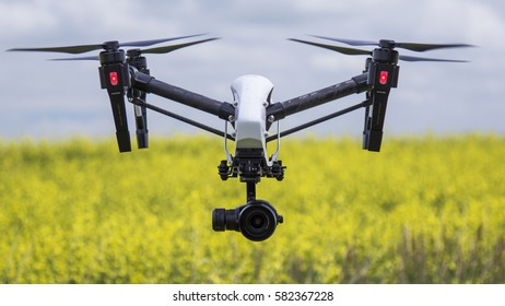 BLACKIE, AB - JULY 13, 2016. A camera drone surveys canola crops on a farm near Blackie, Ab