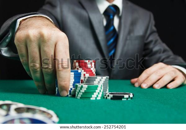 Blackjack At Casino, Man Makes A Bet