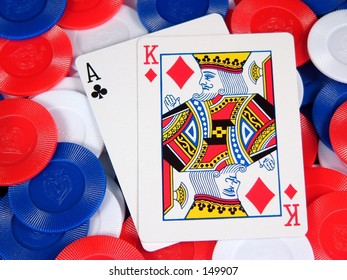 a blackjack hand on a pile of chips