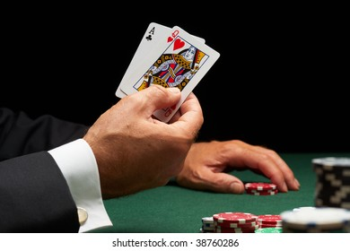 Blackjack player winning hand of cards and casino chips