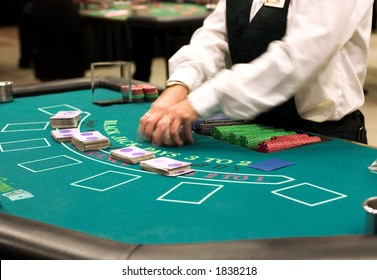 blackjack table at the casino, dealer shifting cards