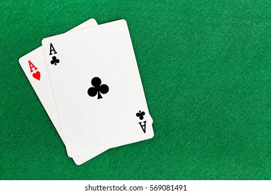 blackjack with two aces on green felt texture
