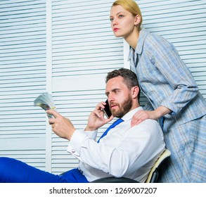 Blackmail and money extortion. Illegal money profit concept. Man speak mobile phone ask for money. Accomplices financial fraud crime. Man and woman earn money on mobile conversation fraud.
