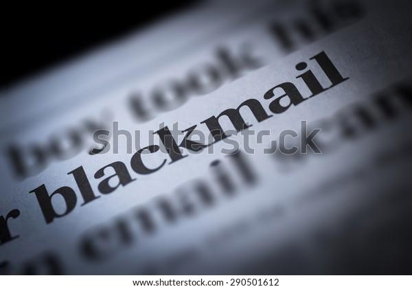 Blackmail written newspaper, shallow dof, real newspaper.