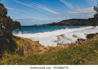 BLACKMANS BAY, TASMANIA - March 6th, 2020: view of the popular Blackmans Bay beach in southern Hobart on a very windy day with intense swell and waves