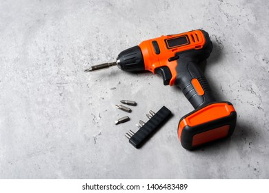 Black-orange cordless screwdriver drill. Power tool for construction and DIY.