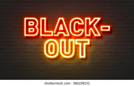 Blackout neon sign on brick wall background
