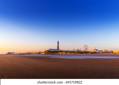 Blackpool Beach at Sunset with North and Central Piers and Blackpool Tower.  Lancashire, England, UK