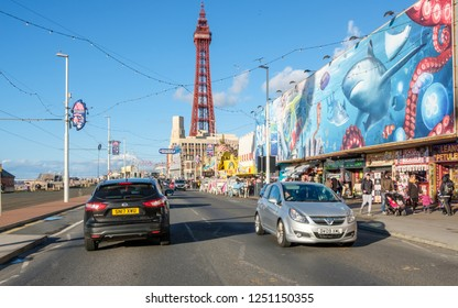 BLACKPOOL, ENGLAND - OCTOBER 26, 2018: Blackpool promenade and Blackpool Tower during an autumn weekend. Blackpool is one of Englands favorite seaside resorts.