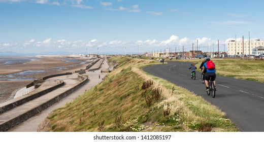 Blackpool, England, UK - August 1, 2015: Cyclists ride on the sea wall and cliff tops between Blackpool and Fleetwood on a summer day.