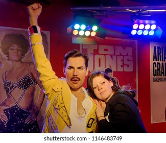 BLACKPOOL, JANUARY 14: Madame Tussauds, UK 2018. Wax statue of Freddie Mercury, best known as the lead vocalist of the rock band Queen and a posing girl.