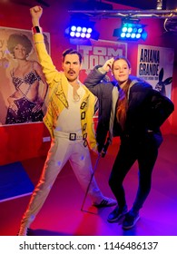 BLACKPOOL, JANUARY 14: Madame Tussauds, UK 2018. Wax statue of Freddie Mercury with a posing girl.