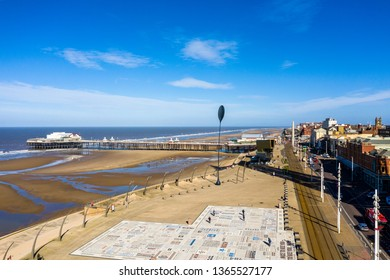 Blackpool - Lancashire - 26th March 2019 - The truly stunning Blackpool pier and beach after a storm turning into a hot Summers day in Lancashire UK, on of the most popular tourist destinations