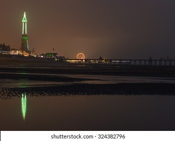 Blackpool, Lancashire, UK. 2nd October 2015. Blackpool Tower and Noth Pier illuminated in late evening light.