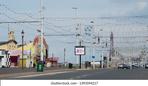 Blackpool, Lancashire/UK - May 7th 2019: Blackpool illuminations during the day, out of season with an empty road and promenade with Blackpool Tower and Ferris wheel  in the background