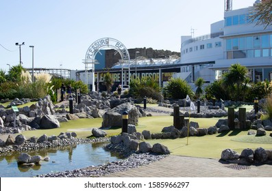 Blackpool, Lancashire/UK - September 21st 2019: view of the putting green on the Golden Mile at Blackpool with the Pleasure Beach sign in the background