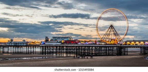 Blackpool pier and beach at sunset