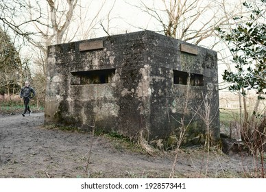 blackpool, uk 03.03.2021 A brutalist cold gritty concrete world war two, ww2, pillbox war bunker defence fortress in a dirty forgotten woodland. wartime relics and forgotten outposts