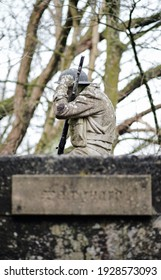 blackpool, uk, 05.02.2021 A gritty concrete world war two air raid soldier sculpture on top of a war bunker defence fortress in a dirty forgotten woodland in europe. wartime conflict relics.