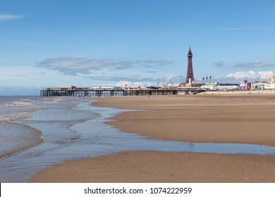 BLACKPOOL, UK - AUGUST 2, 2017: Blackpool Tower and Central Pier as seen from the beach.