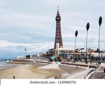 BLACKPOOL, UK - CIRCA JUNE 2016: Blackpool Pleasure Beach resort and Blackpool Tower on the Fylde coast in Lancashire