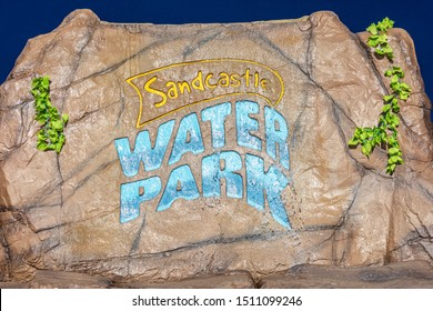 Blackpool,Lancashire/England - 21.09.2019 - Sandcastle Waterpark Blackpool decorative stone logo with over flowing water