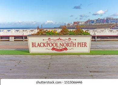 Blackpool,Lancashire/England - 23.09.2019 - Large flower box with welcome to Blackpool North Pier on the side