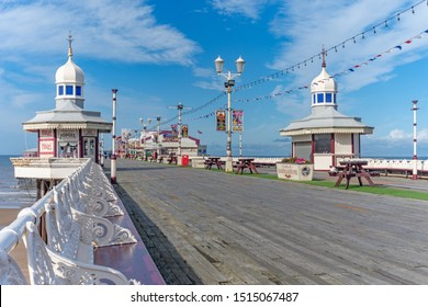 Blackpool,Lancashire/England - 23.09.2019 - Wide shot of Blackpool North Pier showing the old seating and wood flooring
