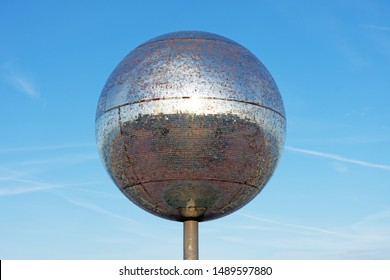 Blackpool,Lancashire/England - 24.08.2019 - The giant mirror ball on the promenade of Blackpool's South Shore is illuminated at night with a colour changing light show.