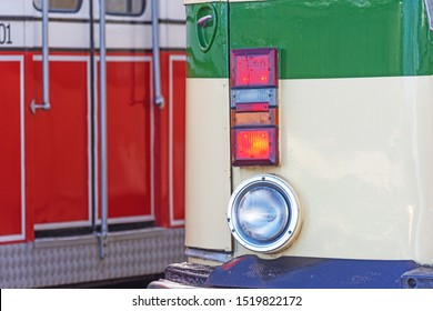 Blackpool,Lancashire/England - 28.09.2019 - Red & white tram doors with crome handles also head light & indicator cluster on cream & green livery