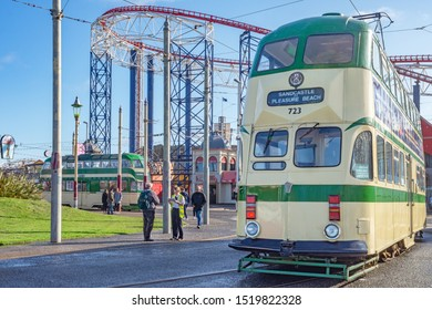 Blackpool,Lancashire/England - 28.09.2019 - Tram model 723 ballon double cream & green livery with pleasure beach in the background