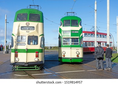 Blackpool,Lancashire/England - 28.09.2019 - Tram models 723 and 717 ballon double cream & green livery with model 701 ballon double red & white livery in the background parked at pleasure beach loop