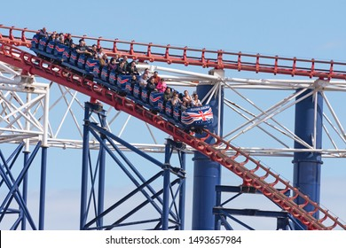 Blackpool,Lancashire/England - 29.08.2019 - A section of the Pepsi Max Big One roller coaster ride with front view of high speed passenger carriage showing people enjoying the ride