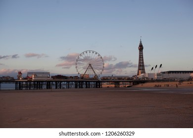 Blackpool,Lancashire,United Kingdom - 29/09/2018 : Blackpool pier at sunset,with Blackpool tower in the background.