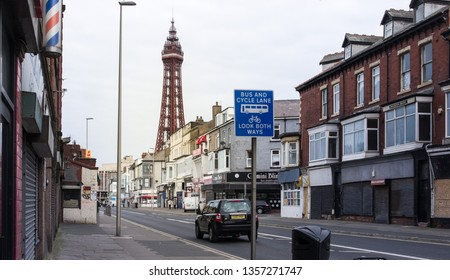 Blackpool,UK,1st April 2019:Central drive, Run-down shops and a view of blackpool tower  also shows some boarded up shops.