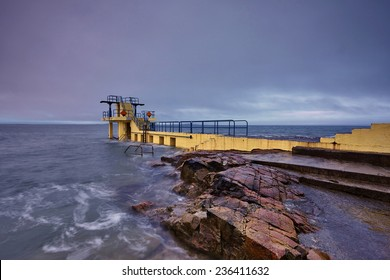 Blackrock Diving Tower is a pier with several diving platforms at different levels and is located at the end of Salthill's promenade with Galway Bay in the background