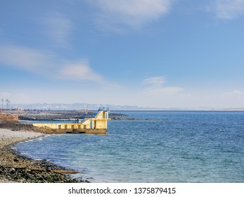 Blackrock diving tower, Salthill, Galway city, Ireland, Sunny day, Clouds in the sky, Landmark tourists spot in Galway.