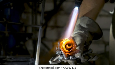 Blacksmith aligns leaves of iron rose and makes the final shape of the flower. Blacksmith makes iron rose