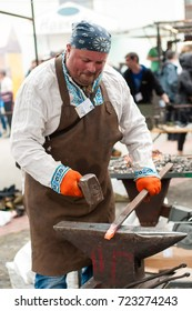 Blacksmith beats with a hammer and melts iron at the international blacksmith festival in Ivano-Frankivsk, Ukraine, in May 2017. Blacksmiths forge iron and create their compositions at the festival.