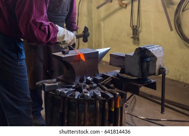 Blacksmith forges a metal product