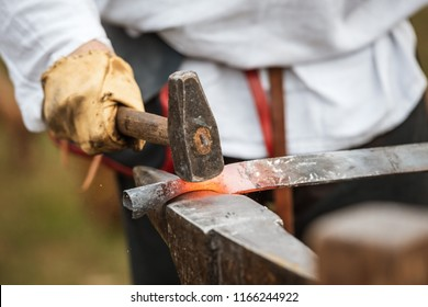 Blacksmith hammering a piece of steel