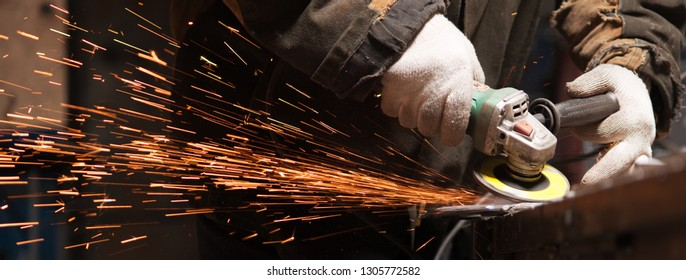 The Blacksmith Polishes Metal Products Using A Grinding Machine In His Own Workshop. Craft Production Concept
