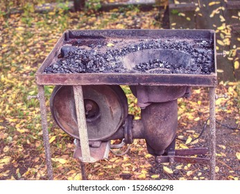 Blacksmith portable furnace with burning coals, tools for hot metal forging workpieces