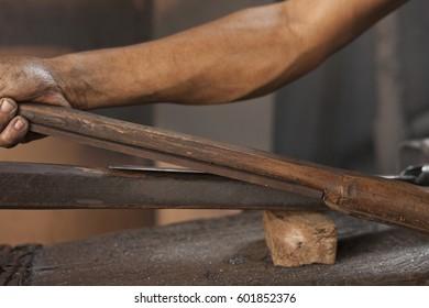 Blacksmith sharpening a blade