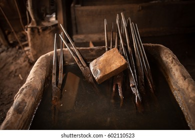 Blacksmith tools in a Cambodian workshop